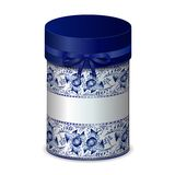 Round gift box with bow and blue pattern in Gzhel style. Stock Photo
