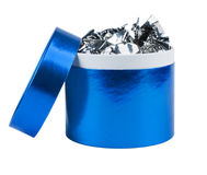 Round gift box with the lid removed, filled with candy. Blue pearl color. Isolated on white background Royalty Free Stock Photo