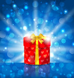 Round gift box on light background with glow Royalty Free Stock Images