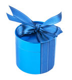 Round gift box, tied with  blue ribbon  bow on top. Stock Images
