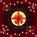 Round Gift box. Top view. Golden and red bow ribbons. Lamp bulb Stock Photos
