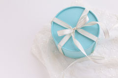 Round gift box with white ribbon. Gift box with white ribbon on white background Stock Image