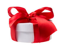 Round gift box wrapped with ribbon Royalty Free Stock Image