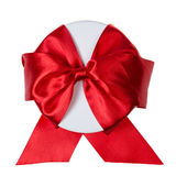 Round gift box wrapped with ribbon Stock Photos