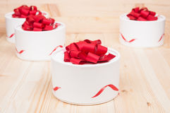 Round gift boxes with red ribbons Royalty Free Stock Image