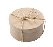 Round gift paper box with twine bow Royalty Free Stock Photography
