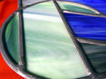 Round Glass. Old fashioned stained glass with round pattern Stock Images