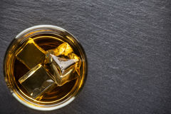 Round glass of aged whiskey Royalty Free Stock Images