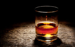 Round glass of cognac Stock Photos