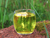 Round glass with a cold drink. On a granite rock Royalty Free Stock Images