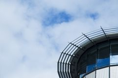 Round glass facade. Detail of the top of a modern business building Stock Image