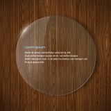 Round glass frame on a wooden background Royalty Free Stock Image
