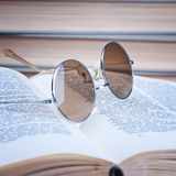 Round glasses on the open book Royalty Free Stock Photography