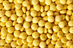 Round glitter yellow tablets Stock Images