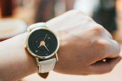 Round Gold-colored Black Analog Watch With Grey Leather Band Royalty Free Stock Photography