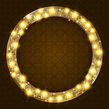 Round gold frame with lights on a dark background Stock Photos