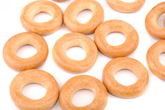 Round golden bagels Royalty Free Stock Image