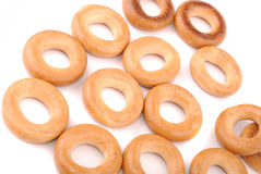 Round golden bagels Royalty Free Stock Photos