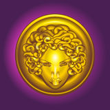Round golden shield with the head of Medusa the Gorgon. Gold head of Medusa the Gorgon Stock Illustration