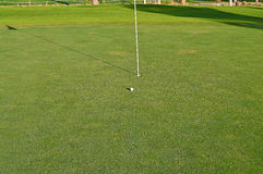 Golf Green A Ball Close To The Flag And Hole Stock Photography