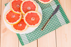 Round grapefruit slices on a plate. Stock Photos