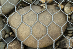 Round gravel in retaining mesh Royalty Free Stock Images