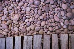 Round gravel and texture of natural wood path use as background, Royalty Free Stock Photos