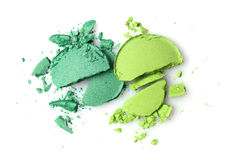 Round green crashed eyeshadows for makeup as sample of cosmetics product Royalty Free Stock Photo