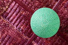 Round green lamp with bamboo weave. Low angle view Round lamp is made of green thread, beautifully weaved hanging on bamboo weave ceiling Royalty Free Stock Photo