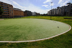 Round green lawn in a residential area of Helsinki Stock Photo