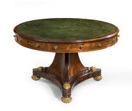 Round green leather topped table English antique vintage Royalty Free Stock Image