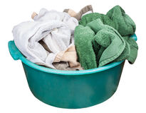 Round green plastic wash basin with dirty clothes Stock Photos