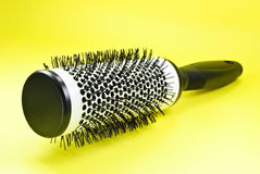Round Hairbrush on Yellow Royalty Free Stock Images