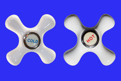 Round handle faucet. Two of faucet knobs with hot and cold water Stock Photo
