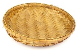 Round handmade rattan basket on white back ground. Round handmade rattan basket .Weaving with rattan core  is one of the more popular techniques being practiced Stock Photos