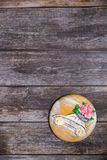 Round handpainted gingerbread on wooden background. Beautiful car with flowers. Flat lay. Copy space. Sweet dessert as a gift for royalty free stock photos
