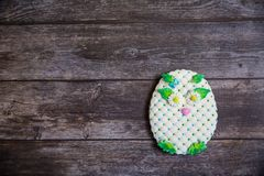 Round handpainted gingerbread on wooden background. White owl. Flat lay. Copy space. Sweet dessert as a gift for women`s stock images