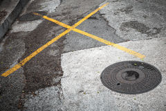 Round hatch on asphalt road Stock Image
