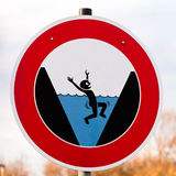 Round hazard sign warning for danger of drowning. Circular hazard sign warning of danger of drowning with a pictorial illustration showing a person trapped by royalty free stock photography