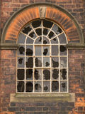 Round-headed window with broken panes Royalty Free Stock Photos
