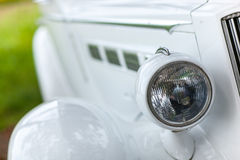 Round headlight on the retro car. Royalty Free Stock Photo