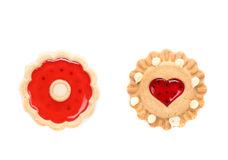 Round and heart shaped strawberry biscuit. Close up. White background Stock Images
