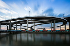 Round highway intersection road with moving cloud waterfront Royalty Free Stock Photo