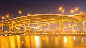 Round highway intersection water front night. View and river front Stock Image