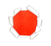 Round hole in paper. On red background inside Royalty Free Stock Image