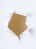 Round hole in paper. Over white background Stock Image