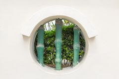 Round hole - window in white wall stock image