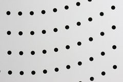 Round holes in a metal surface Stock Image