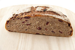 Round homemade whole grain bread with cranberry and walnut on a Royalty Free Stock Images