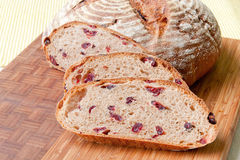 Round homemade whole grain bread with cranberry Stock Photo